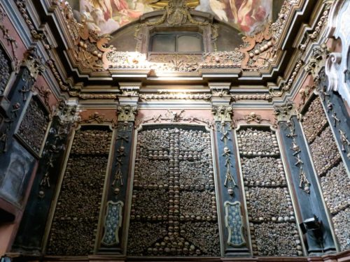 The bone chapel of Milan, where the walls are decorated with the bones of plague victims.